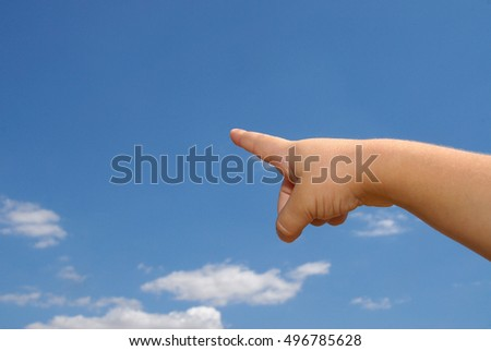 hand pointing, with the sky background