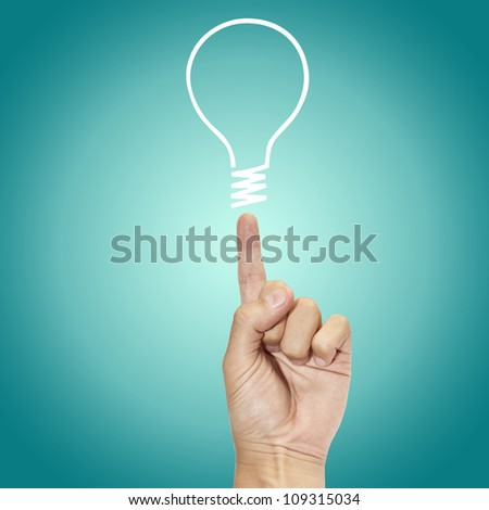 hand points to drawing light bulb - stock photo