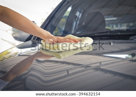 Hand polishing the car hood ,using microfiber cloth for cleaning