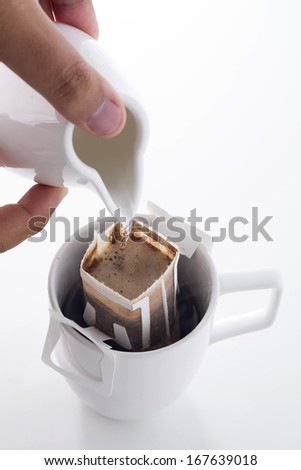 Hand pouring hot water to Drip bag fresh coffee - stock photo