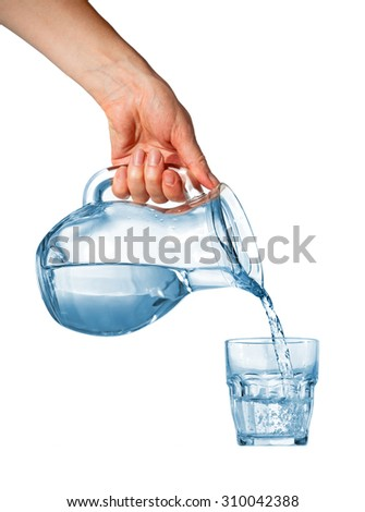 Hand pouring water from glass pitcher to glass over white background - stock photo