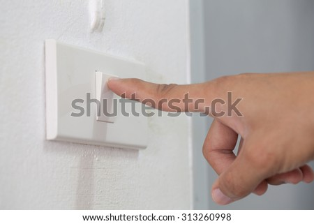 Hand power switch on the lights. - stock photo