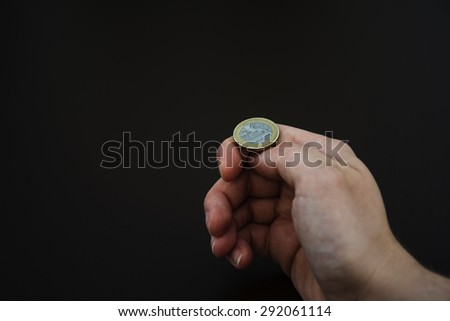 Hand prepare to throw a coin - stock photo