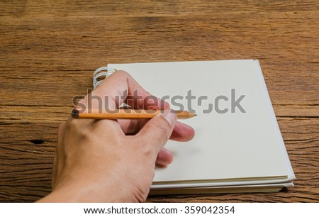 hand prepare to write on notebook with pencil, business concept