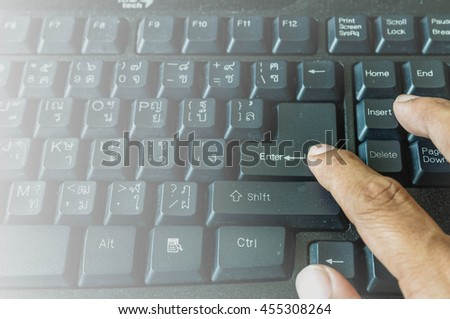 Hand press enter on key board - stock photo
