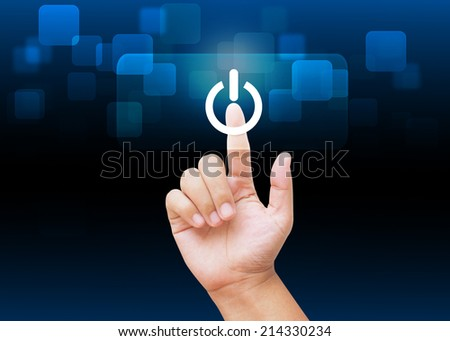 Hand press on button on-off on technology background - stock photo