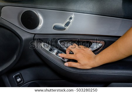 hand press on car automatic windows control