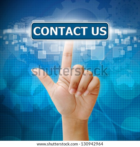 Hand press on CONTACT US button - stock photo