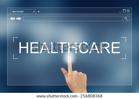 hand press on healthcare button on webpage - stock photo