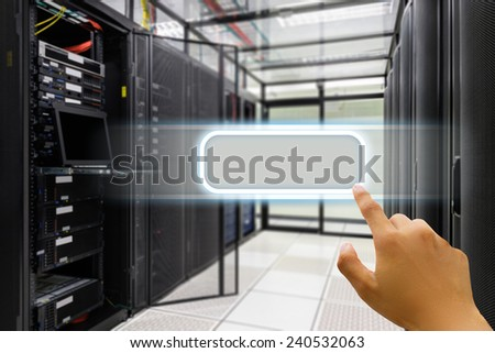 Hand press on window icon in data center server room.