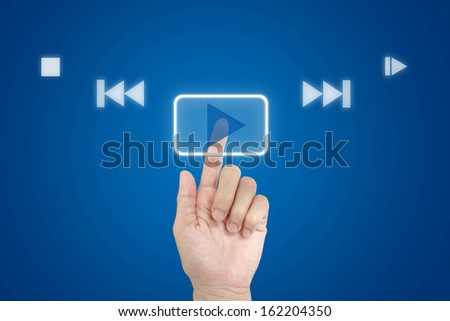 Hand press play button. - stock photo