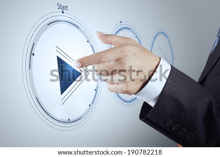 hand press play button sign to start or initiate projects as concept  - stock photo