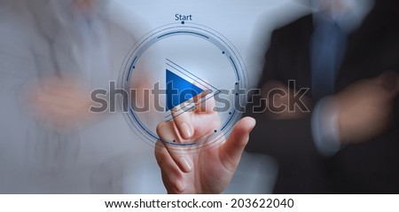 hand press play button sign to start or initiate projects with his team as concept  - stock photo