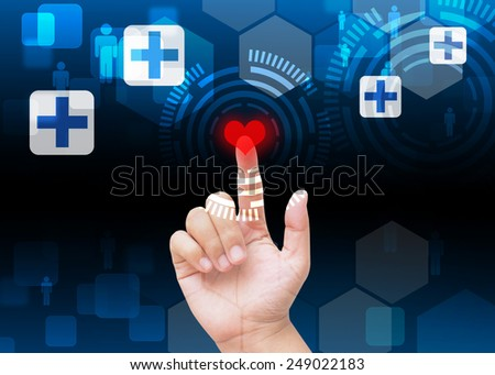 Hand press red heart button on medical background