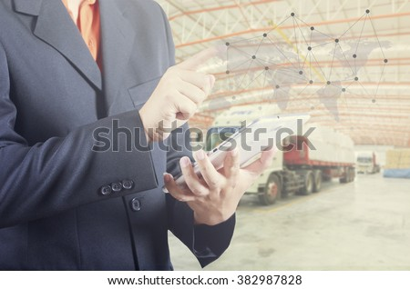 hand presses on world map with digital tablet,export and import goods prepare the delivery of powder bag in warehouse with truck background (Elements of this image furnished by NASA) - stock photo