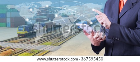 hand presses on world map with digital tablet,Industrial Container Cargo Trains And Truck Of Land Logistic  for Logistic Import Export background (Elements of this image furnished by NASA) - stock photo