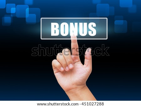 Hand pressing BONUS button on technology background