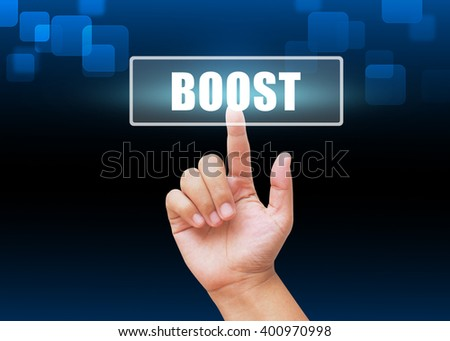 Hand pressing Boost button with technology background