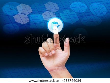 Hand pressing buttons with science& technology background  - stock photo