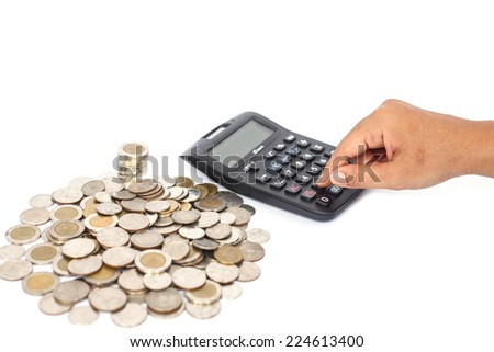 Hand pressing calculator and stack of coin isolated on white background - stock photo