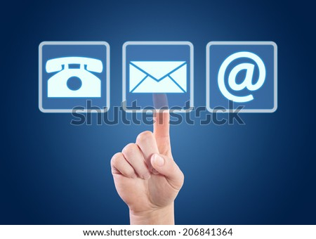 Hand pressing contact buttons on interface with blue background. - stock photo