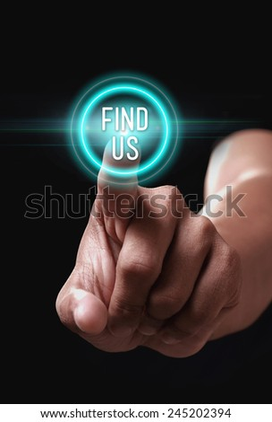Hand pressing find us icon on a virtual screen - stock photo
