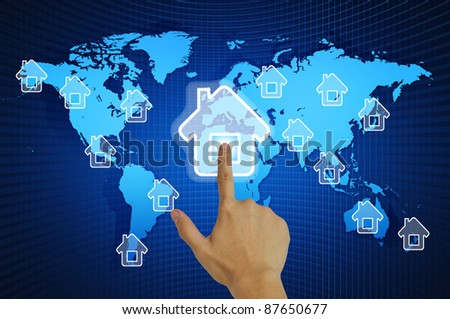 Hand pressing home symbol  on world map