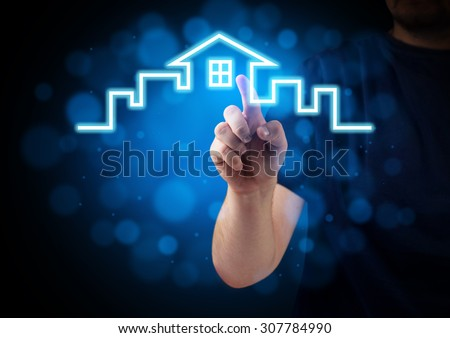 Hand pressing House Icon on the virtual keyboard - stock photo