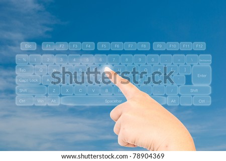 Hand pressing keyboard on the blue sky.