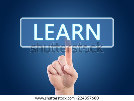 Hand pressing Learn button on interface with blue background. - stock photo