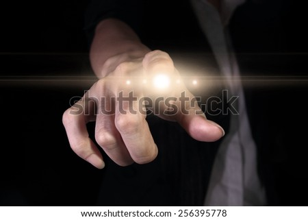 Hand pressing light button on the virtual screen
