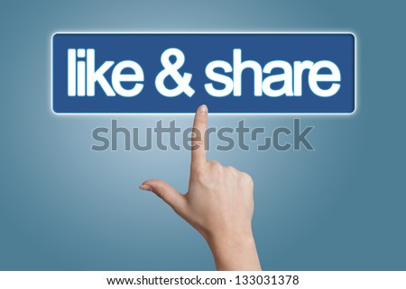 Hand pressing like & share button isolated on blue background - stock photo