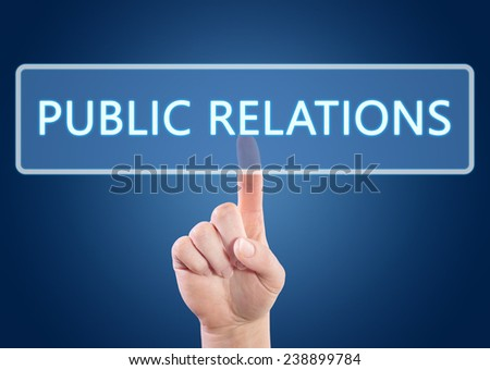 Hand pressing Public Relations button on interface with blue background. - stock photo