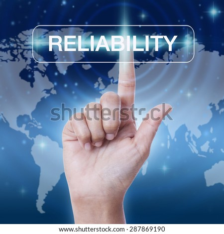 hand pressing reliability word button on virtual screen. business concept - stock photo
