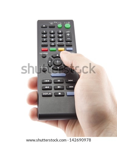 Hand pressing remote control isolated on white - stock photo