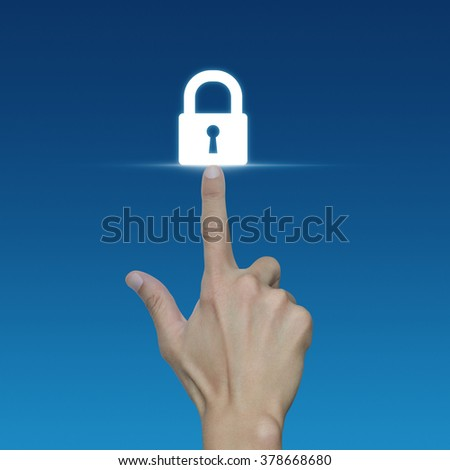 Hand pressing security key button on virtual screen, Technology information security and data encryption concept - stock photo
