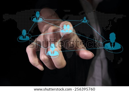 Hand pressing social network on the virtual screen - stock photo