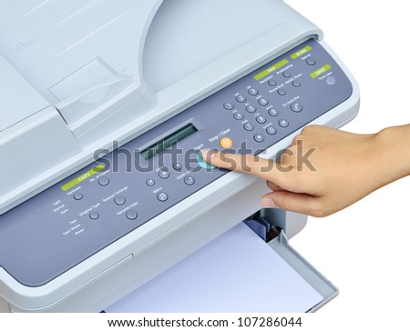 Hand pressing Start button on printer - stock photo