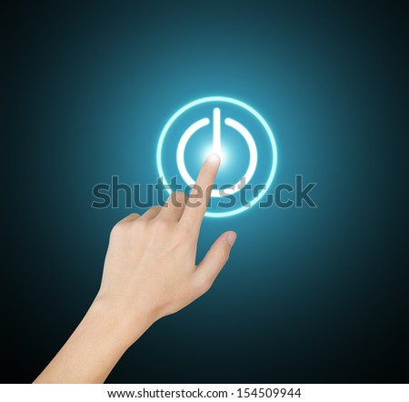 hand pressing start button on touch screen - stock photo