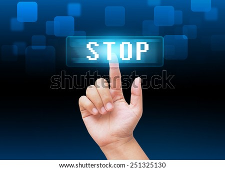 Hand pressing stop buttons with technology background  - stock photo
