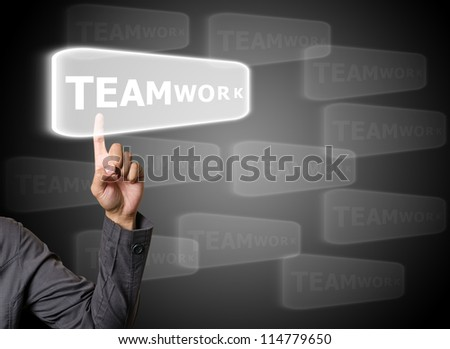 hand pressing teamwork button on a touch screen interface - stock photo