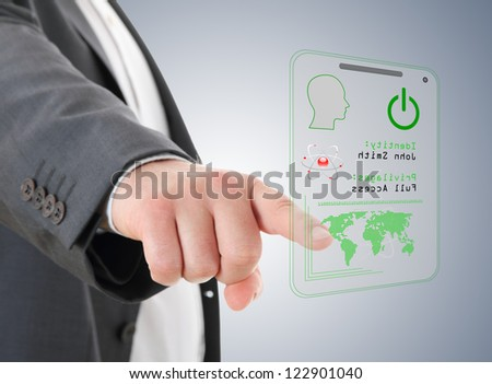 Hand  pressing the access card - stock photo