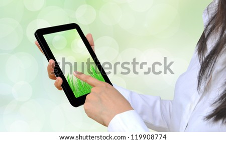 hand pressing touch pad PC - stock photo