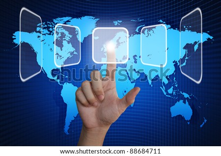 Hand pressing touchscreen button on the world background - stock photo