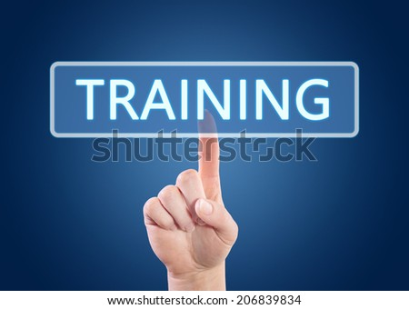Hand pressing Training button on interface with blue background. - stock photo