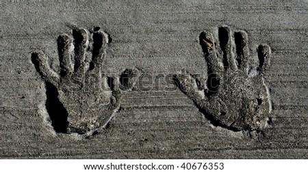 Hand Prints in Concrete - stock photo