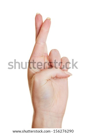 Hand promising an oath with two fingers crossed - stock photo