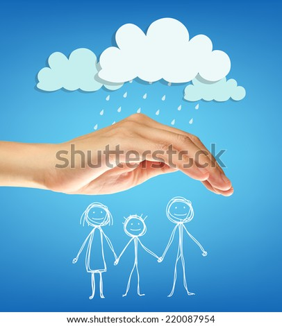 Hand protect the family from raining. - stock photo
