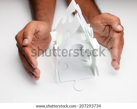 Hand protecting house - stock photo