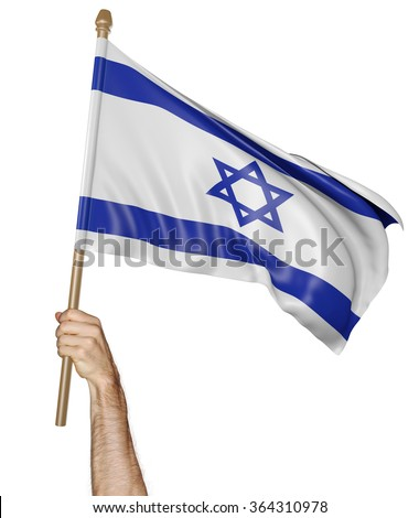 Hand proudly waving the national flag of Israel - stock photo